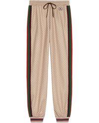 Gucci Pantalon en jersey à imprimé GG - Neutre