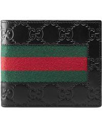 Gucci Portemonnaie aus Signature Leder mit Webstreifen - Schwarz