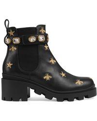 Gucci Botines de piel con bordado - Negro