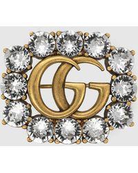 Gucci Doppel G Brosche aus Metall mit Kristallen - Mettallic