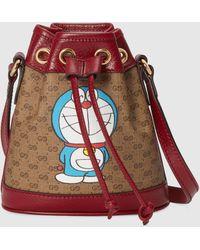 Gucci - 【公式】 (グッチ)ドラえもん X ミニ バケットバッグ Detail 2ミニGGキャンバスベージュ - Lyst