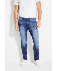 Guess - Slim Tapered Ultimate Flex Jeans - Lyst
