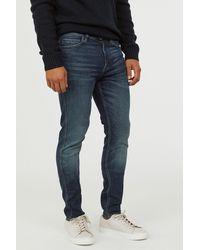 H&M - Tech Stretch Slim Jeans - Lyst