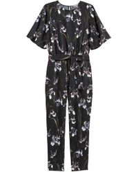 e9253a7eace Lyst - H M Patterned Jumpsuit in Black