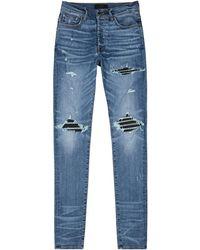 Amiri Mx1 Blue Leather-panelled Skinny Jeans