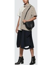 JW Anderson - Cut Out Flared Short - Lyst