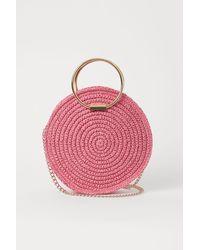 H&M Runde Basthandtasche - Pink