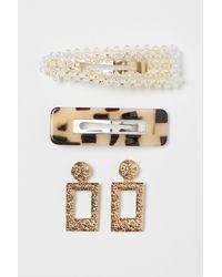 H&M Ohrringe und Haarspangen - Mettallic