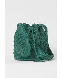 H&M Buckettasche aus Stroh - Grün