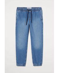 H&M Pantalon jogger Regular Denim - Bleu