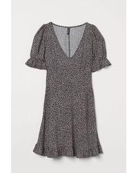 H&M Robe à motif - Noir