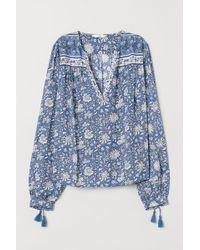 H&M Bluse mit V-Ausschnitt - Blau