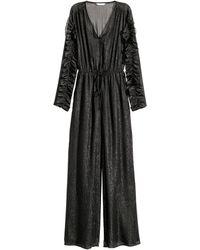 H&M Glitterende Jumpsuit - Zwart