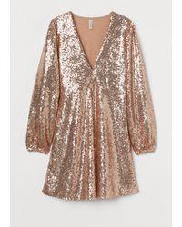 H&M Robe à paillettes - Neutre