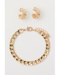 H&M Boucles d'oreilles et bracelet - Métallisé