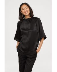 Lyst H M Frilled Blouse In Black