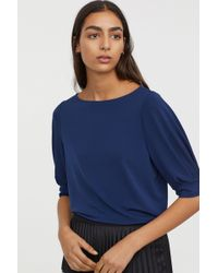 03f298404c6484 Lyst - H M Sleeveless Tie-front Blouse in Blue