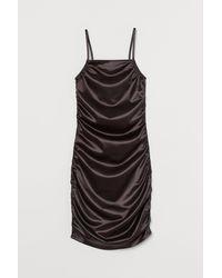H&M Robe métallisée - Noir