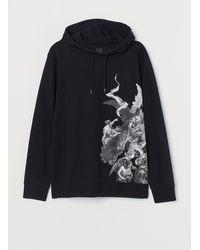 H&M Sweat à capuche avec motif - Noir