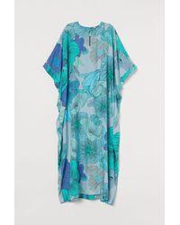 H&M Caftan à grandes fleurs - Bleu