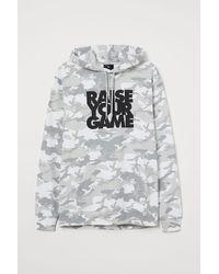 H&M Hoodie mit Druck - Grau
