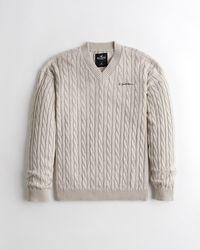 Hollister Lässiger Pullover mit V-Ausschnitt und Zopfmuster - Mehrfarbig