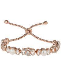 Mikey Daisy Cubic Disc Pearl Tieup Bracelet - Metallic