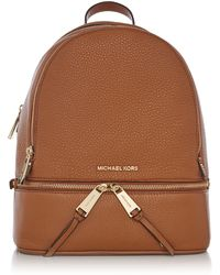 7dd7f6af8f1c Lyst - Michael Kors Rhea Zip Extra Small Messenger Backpack in Natural