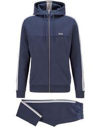 BOSS by HUGO BOSS Regular-Fit Trainingsanzug aus Baumwoll-Mix mit Kontraststreifen - Blau