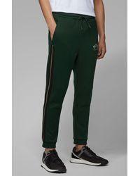 IOAAD Pantalon De Sport Pantalon De Surv/êtement pour Hommes Pantalon De Poche Solide /À Cordon De Serrage Pantalon De Jogging