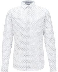 BOSS Chemise Slim Fit à motif en fil coupé, avec col à pointes boutonnées - Blanc