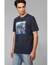 BOSS by Hugo Boss T-shirt en coton à imprimé graphique emblématique de la collection - Bleu