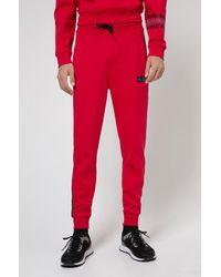 HUGO Bas de survêtement en molleton de coton avec logos imprimé pneu - Rouge