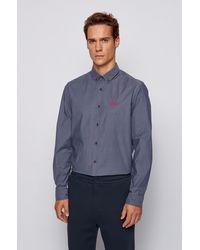 BOSS by HUGO BOSS Chemise Regular Fit en popeline de coton stretch, avec col à pointes boutonnées - Bleu