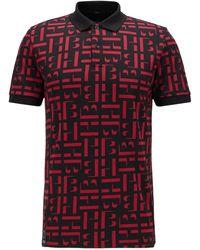 BOSS by HUGO BOSS Slim-Fit Poloshirt aus Bio-Baumwoll-Piqué mit Monogrammen - Rot
