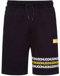 HUGO Shorts Van Katoenen Sweatstof Met Logoprints In Bandafdruk-stijl - Zwart
