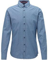 BOSS Chemise Slim Fit à motif en fil coupé, avec col à pointes boutonnées - Bleu