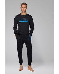 BOSS by HUGO BOSS Pantalones homewear en felpa de rizo con detalles en contraste - Negro