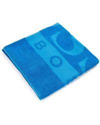 BOSS by HUGO BOSS Toalla de playa de rizo de algodón con logo tejido en jacquard - Azul