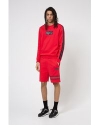 HUGO Sweater Van Katoenen Sweatstof Met Logoprint In Bandafdruk-stijl - Roze
