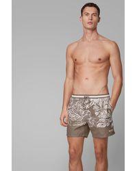 BOSS by HUGO BOSS Bañador tipo shorts de secado rápido con estampado floral - Marrón
