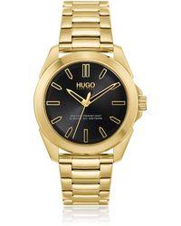 HUGO Goldfarbene Uhr mit Gliederarmband und schwarzem Zifferblatt - Mettallic