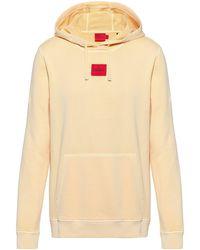 HUGO Kapuzen-Sweatshirt aus Baumwolle mit rotem Logo-Label - Orange