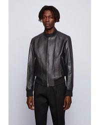 BOSS by HUGO BOSS Veste Regular Fit en cuir nappa avec détails en maille côtelée - Noir