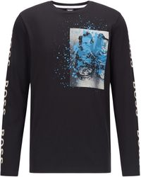 BOSS by HUGO BOSS Katoenen T-shirt Met Lange Mouwen, Artwork En Logo's - Zwart