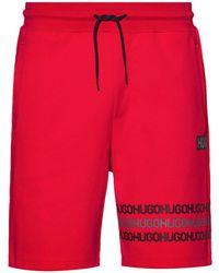 HUGO Shorts aus Baumwoll-Terry mit Reifenspuren-Logos - Rot