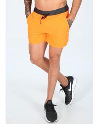 Nike Pantalón corto Tech Pack - Naranja