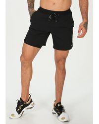 Nike Pantalón corto Flex Stride 2en1 - Negro