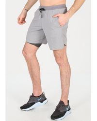 Nike Pantalón corto Flex Stride 2en1 - Gris