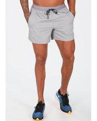 Nike Pantalón corto Flex Stride - Gris